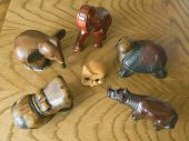 picture of pack-rat  - alien - wooden toys (mammoth elephant turtle hippo rhino)