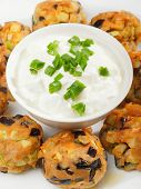 stock photo of meatball  - Eggplant meatballs with white sauce shot from above - JPG