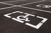 stock photo of physically handicapped  - Parking places with handicapped or disabled signs and marking lines on asphalt - JPG