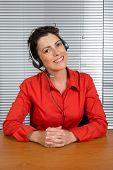 stock photo of helpdesk  - female customer service operator helpdesk support red shirt - JPG