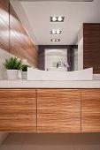 foto of exclusive  - Exclusive modern bathroom in wooden style - JPG