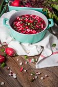 stock photo of chives  - Beetroot soup with chives and radishes on the boards - JPG