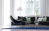 stock photo of settee  - Low angle view of a comfortable simple living room interior with an armchair and settee in front of sunny windows with a decorative glass vase on a low table - JPG