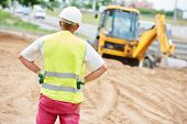 pic of millwright  - adult construction site manager worker at earthmoving roadwork  - JPG