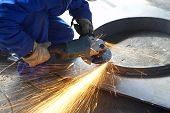 Worker Grinding, Finishing, Welding Metal