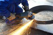 Worker Grinding, Finishing, Welding Metal