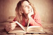 pic of girl reading book  - Girl dreams reading the book - JPG