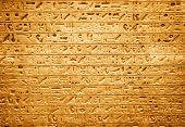 Egyptian hieroglyphs. High contrast and red tint.