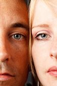 closeup young natural attractive couple with blue eyes