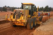 stock photo of heavy equipment  - grader heavy earth moving equipment - JPG