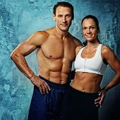 stock photo of abdominal muscle  - Beautiful athletic couple - JPG