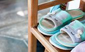 Sleepy-rabbit Pattern Sandals Are Placed On Shoes Shelf, The Sandals Give Lazy Feeling poster