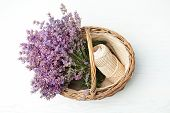 Wicker Basket With Lavender Flowers And Rope On Light Background, Top View poster