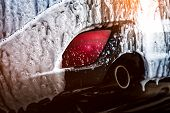Blue Compact Suv Car With Sport And Modern Design Washing With Soap. Car Covered With White Foam. Ca poster