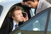 stock photo of pep talk  - Businessmen talking before a meeting - JPG