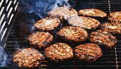 Preparing Delicious Hamburgers On The Outdoor Grill For Family Lunch. Conceptual Picture Of Grilled  poster