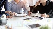 Consult Business Group Businessman Planning And Consulting On Office Table. poster