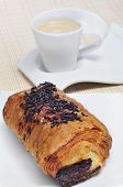an exemple of continental breakfast: pain au chocolat and cappuccino