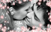 Monochrome Picture Of Sweet Couple In Bed With Flowers