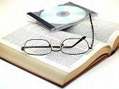 Glasses & CD On Book