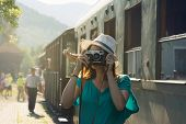 Traveler Girl Taking Photo In Train Station. Girl Traveling Alone In Train Station Taking Photo. Tra poster