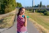 Happy Fit Young Woman Full Of Vitality Working Out In Early Morning Light In An Urban Park Smiling A poster