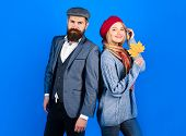 Autumn. Stylish Couple In Warm Clothes. Bearded Man Standing With Girlfriend. Woman In Warm Clothes  poster
