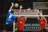 KAPOSVAR, HUNGARY - NOVEMBER 13: Karoly Lesznyik (L) in action at a Hungarian National Championship volleyball game Kaposvar (blue) vs. Nyiregyhaza (red), November 13, 2011 in Kaposvar, Hungary.