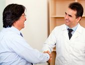 Business man making a successful sele to a doctor and handshaking