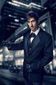 Film Noir. Retro Style Fashion Portrait Of A Killer. A Man In A Suit With An Umbrella In His Hand Ag poster