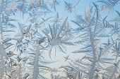 The abstract frosty pattern on glass