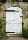 Old White Wooden Door To Walled Garden