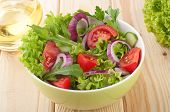 Fresh Salad With Cucumbers Tomatoes And Onions