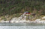 Steep Coast With House In Norway