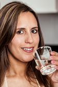 Woman Smiling With A Glass Of Water