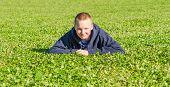 Pretty Boy Lying On The Fresh Grass