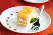 stock photo of curd  - A piece of fruit cake with curd cream - JPG