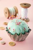 Green Pincushion In An Old Metal Cupcake