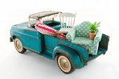 stock photo of moving van  - Old vintage toy truck packed with furniture  - JPG