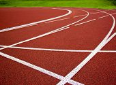 image of track field  - Athletics Start track lanes 1 2 3 of a red running racing track - JPG