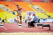 MOSCOW - JUN 11: Female jumper in long jump place at Grand Sports Arena of Luzhniki OC during Intern