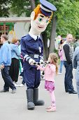 MOSCOW - JUNE 1: Girl with large puppet Militiaman at III Moscow Festival of puppets and game progra