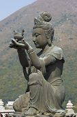 stock photo of lantau island  - Buddha statue at Po Lin Buddhist Monastery located on Ngong Ping Plateau on Lantau Island - JPG