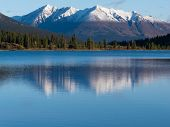 Snowcapped mountain reflection on Lapie Lake Yukon