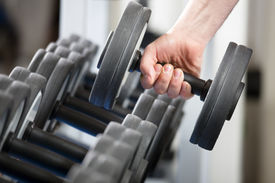 picture of weight-lifting  - close up of man holding weight in gym - JPG