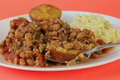 stock photo of creole  - Large plate of Creole Cooking is Chicken Gumbo over cornbread with large scoop of mashed potatoes - JPG