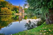 pic of yellow castle  - Autumn landscape with lake and old mansion - JPG