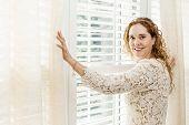 Smiling Woman Near Window