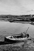 Old Beached Fishing Boat On Irish Beach In Black And White