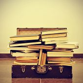 a pile of books in an old suitcase with a retro effect